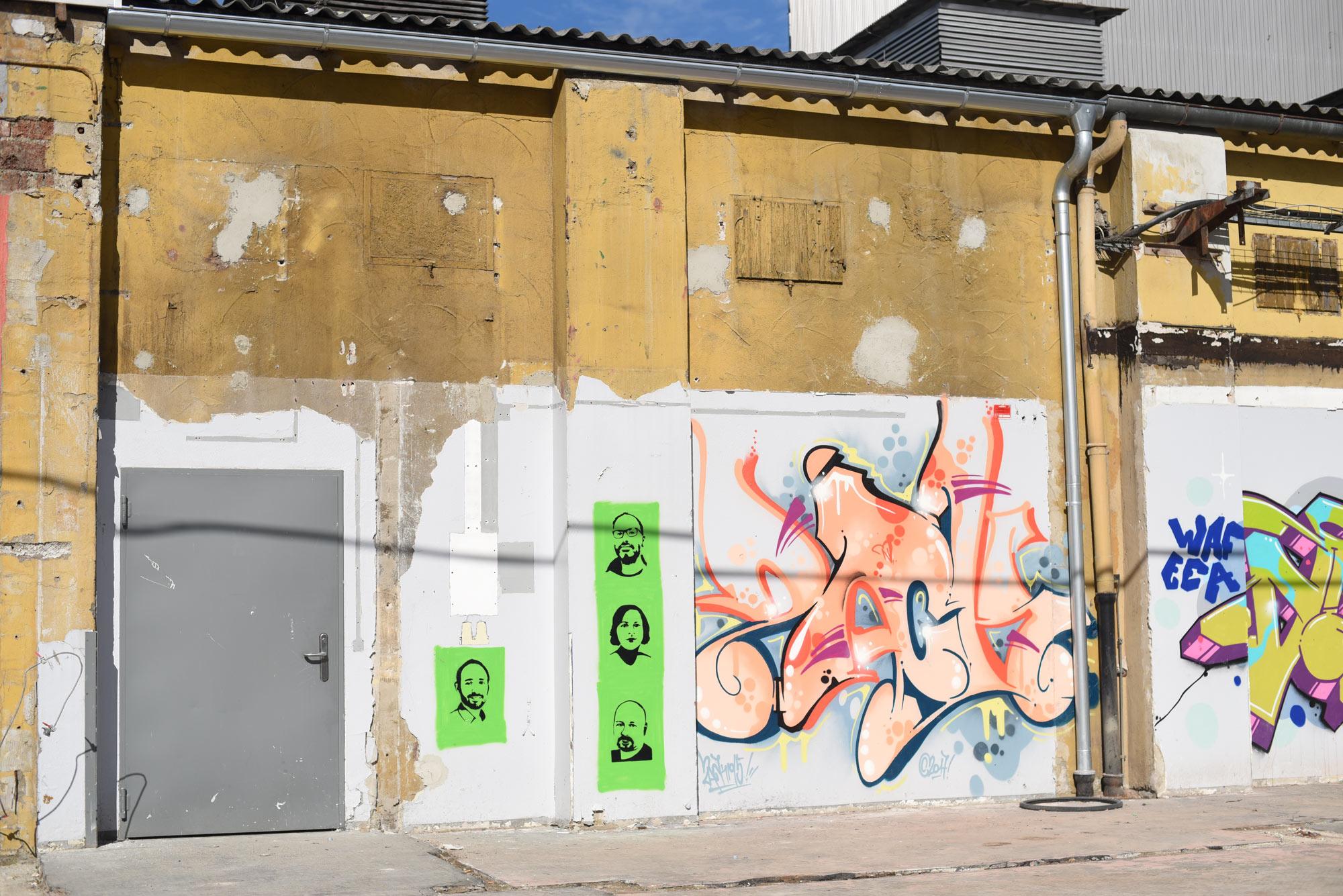 Foto der fertigen Graffitis an der Wand im WERK 3